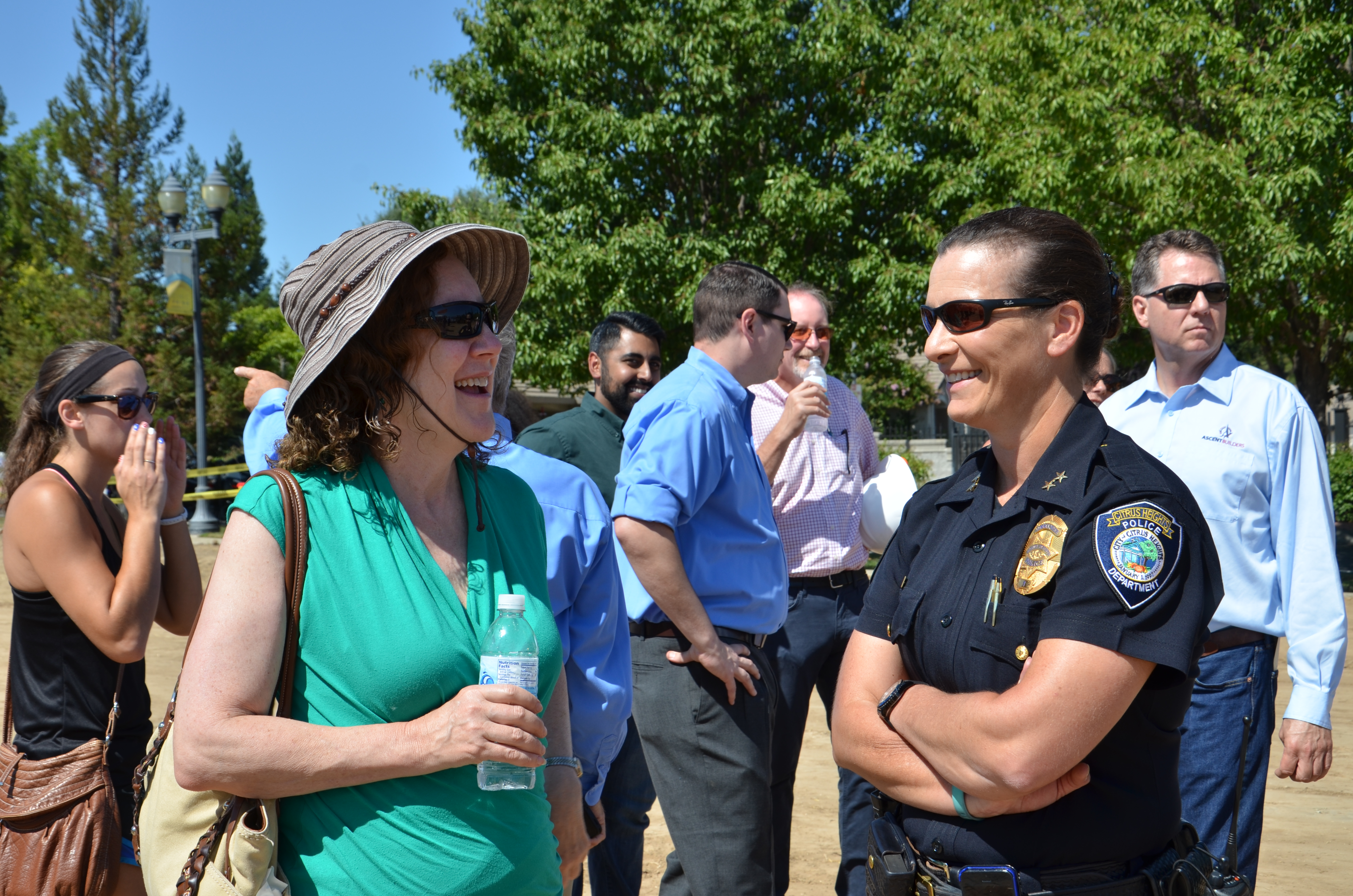 Community members and police officers mingle
